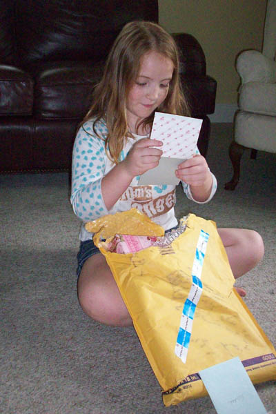Rebekah reading the card from her Grandma